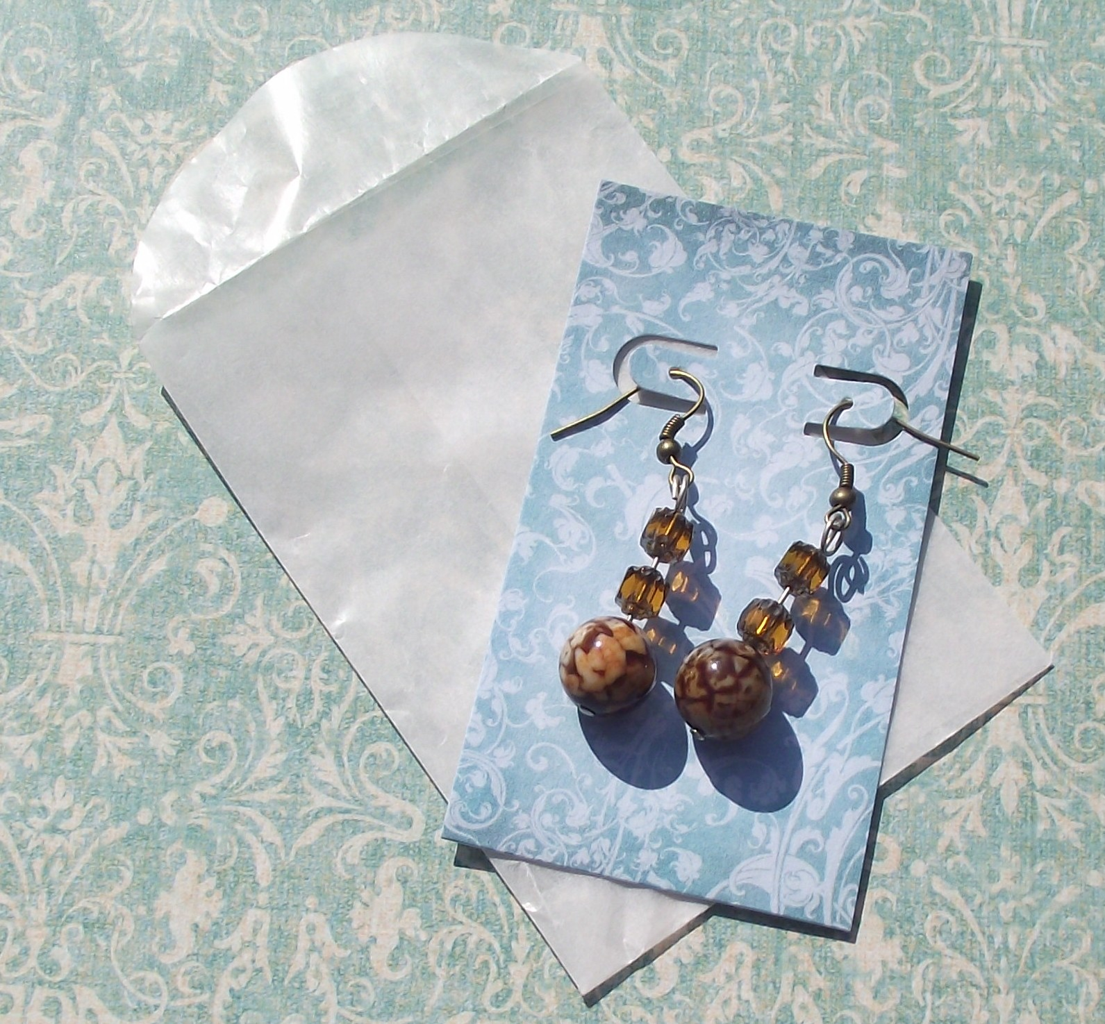 Supplies: Earring Card Adapters, Envelopes, Clear Cello Sleeves